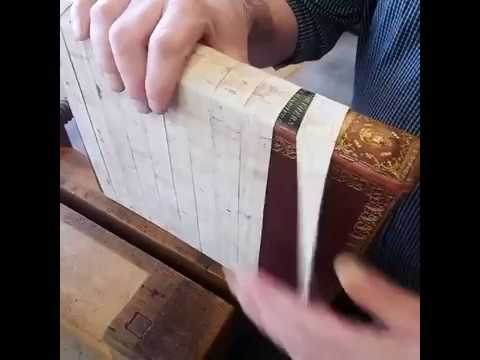 Bookbinder Unwraps a Leather Joint Repair to Show the Result
