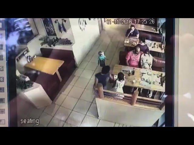Caught on film: Stranger snatches child at restaurant
