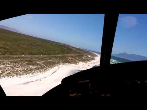 Sport Helicopters, Cape Town. Huey Helicopter low level flying UH1
