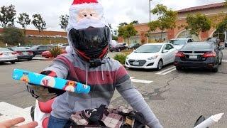 Motorcycle Santa Passes Out Christmas Presents