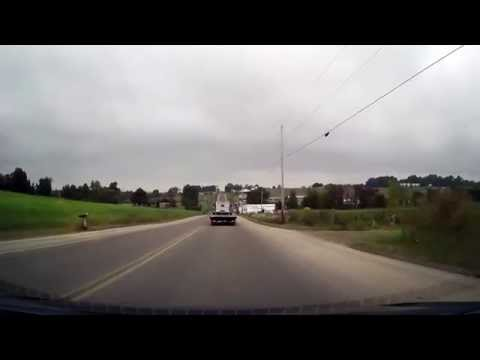 Driving in Rural Amish Country in Ohio past buggies and Amish Schools