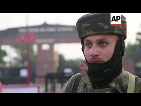 Indian soldiers battle with militants in Kashmir army camp