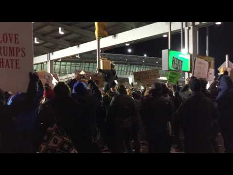 """Protesters singing """"This Land Is Your Land"""" at JFK Airport, 1/28/2017"""