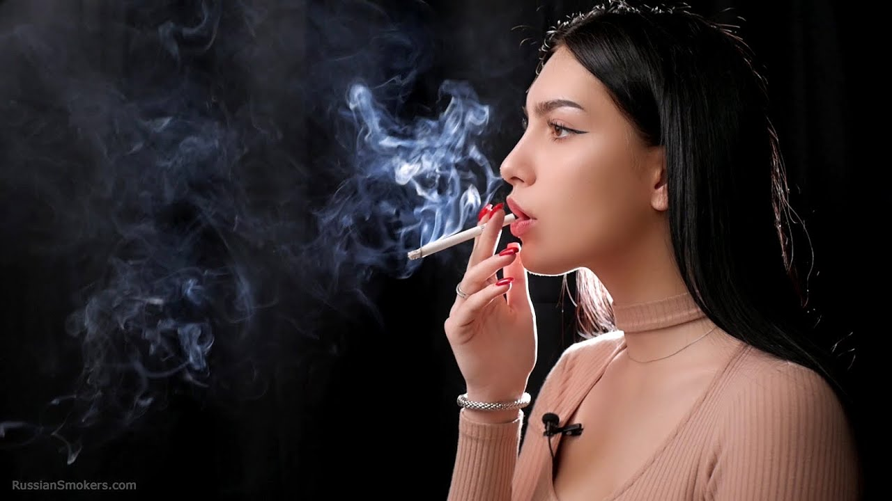 Closeup portrait of sexy young girl in pool vapor concept vaping ecigarette stock photo