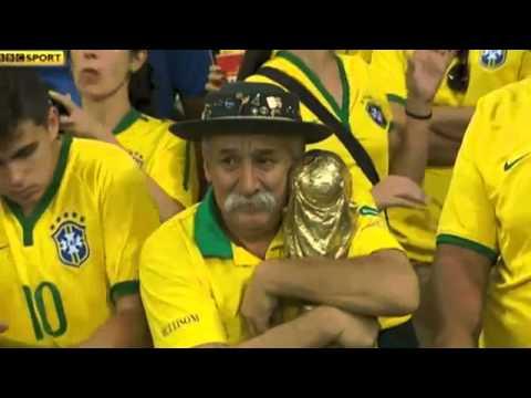Sad Brazilian fan holding World Cup