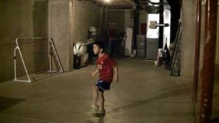 u7 6 year old boy showing off his skills and playing soccer football