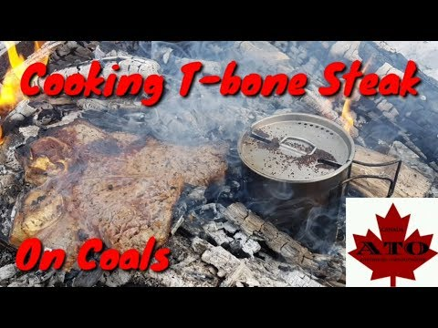 Cooking T-bone Steak On Coals and fire tips