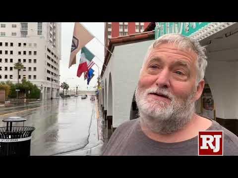 Tourists enjoy rain in downtown Las Vegas