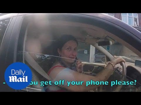 This is the shocking moment driver refuses to get off her phone