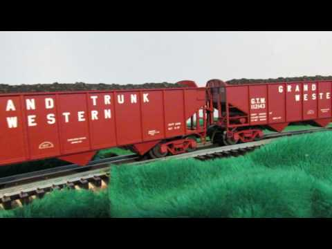 Grand Trunk Western Pacific steam locomotive and freight cars in O scale.