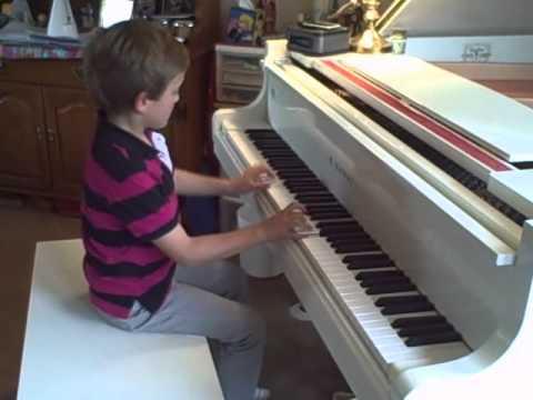 Gil, 7, Plays Indiana Jones Theme on Piano w/ Movie Soundtrack
