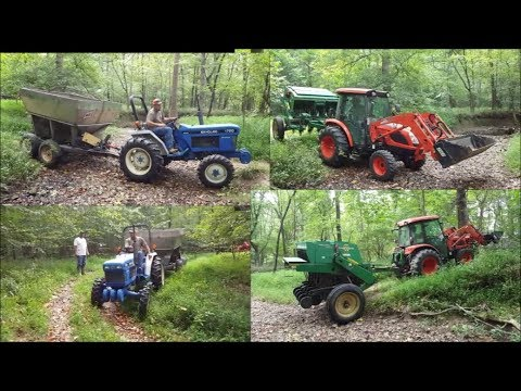 EXTREME Land Management-2 Tractors with major weight crossing ditches