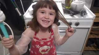 6 year old Vivian bakes her first cake; funny video