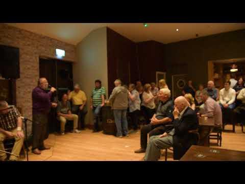 Clr.John Crowe singing at Greyhound Bar Sixmilebridge.