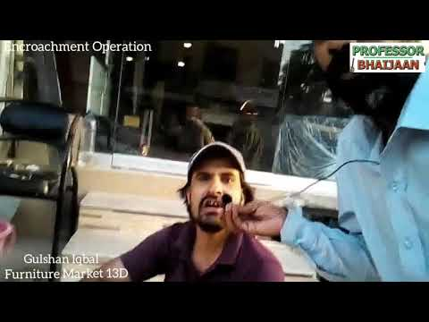 Karachi Encroachment Gulshan Iqbal Furniture Market 13D - Shopkeepers removing encroachment boards