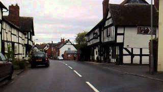 Driving through Pembridge, UK, in my Rx3 coupe,  past  800 year old buildings.