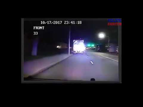 Police Officer dash cam catches semi truck driving down wrong side of road