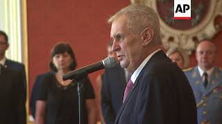Zeman swears in new government led by billionaire Andrej Babis