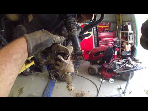 900 rzr  trail wheel bearing service  using machined intergrations bearing grease tool