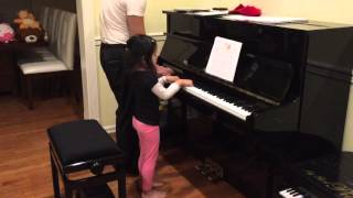 Agatha playing Groove Tune piano duet with daddy