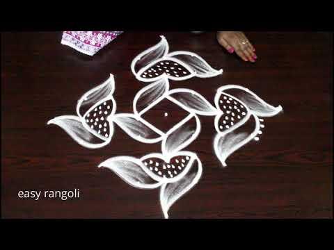 Simple n cute daily kolam with 9 dots by easy rangoli Suneetha || new muggulu patterns