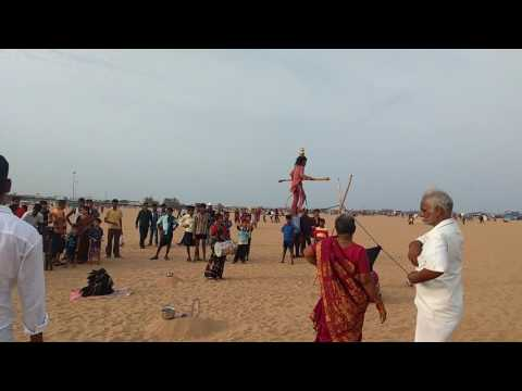 Small girl doing stunts to feed family, in Chennai marine beach