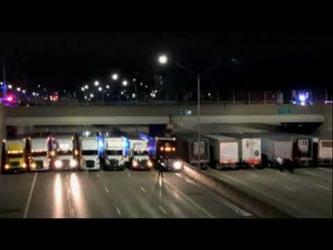 13 Semis Line Detroit Freeway to Help Man Considering Suicide