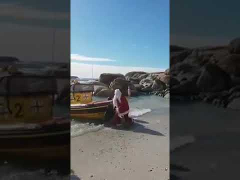 Jonny Hartwell - SANTA FAIL: Santa Somersaults Out A Boat Onto the Beach