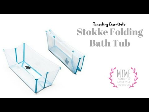 Splashing around in the Stokke Bath Tub (foldable, great for travel)