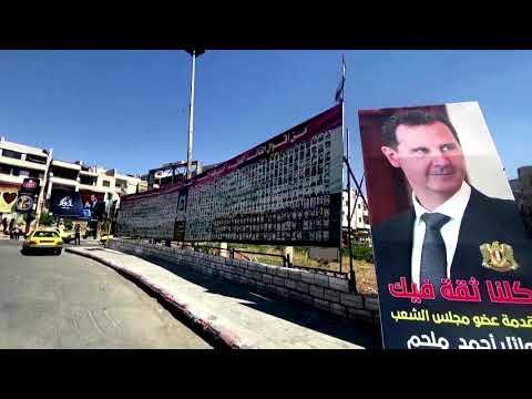 Homs voters support Assad amid ruins of war