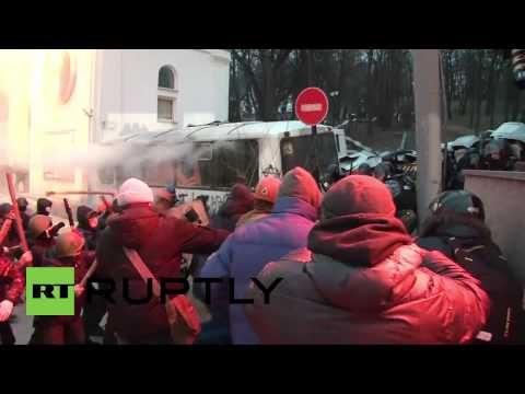 Ukraine:  Kiev protesters beat police officers with clubs