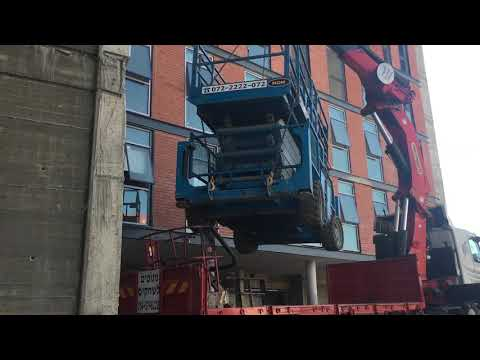 Giant crane lifting a large piece of heavy metal part 3