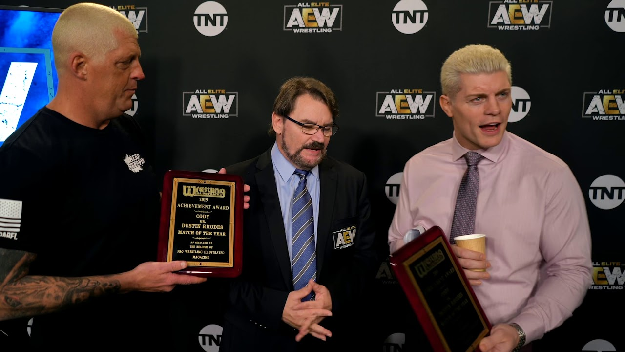 CODY & DUSTIN RHODES ACCEPT THE PRO WRESTLING ILLUSTRATED MATCH OF THE YEAR AWARD
