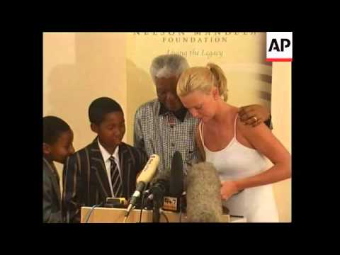 VOICED Hollywood actress Charlize Theron meets Mandela Mp3
