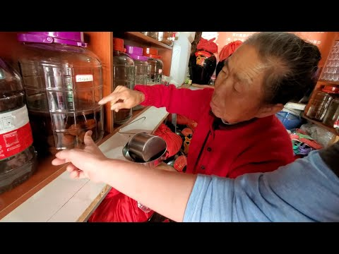 Going LOCAL in WUHAN CHINA (old lady homemade baijiu alcohol, fermented rice & street food in tent)
