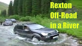Скачать SsangYong Rexton Crossing A Kensu River Ford In An Off Road Trip