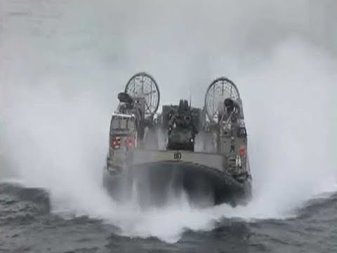 Navy LCAC Hovercraft Transporting Marines And Equipment