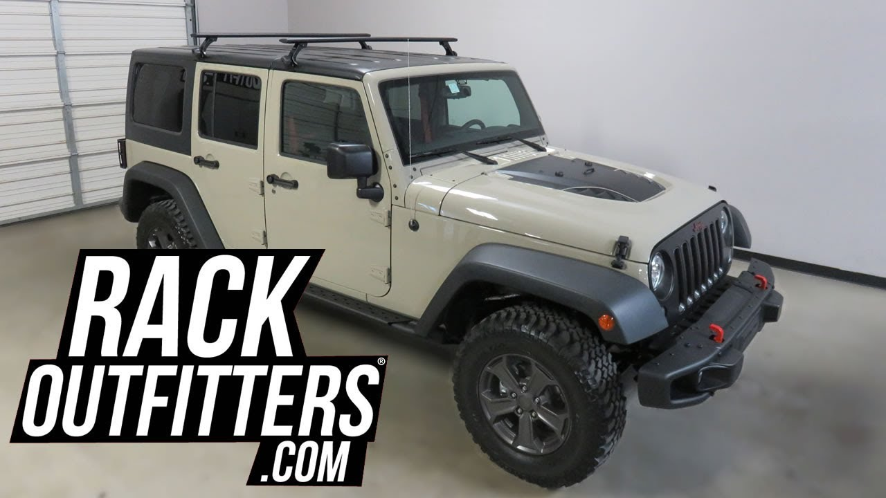 jeep wrangler unlimited rubicon recon with thule 300r rapid gutter foot aeroblade roof rack