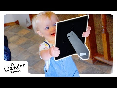 TODDLER REACTS TO MOM'S BABY PICTURES!!