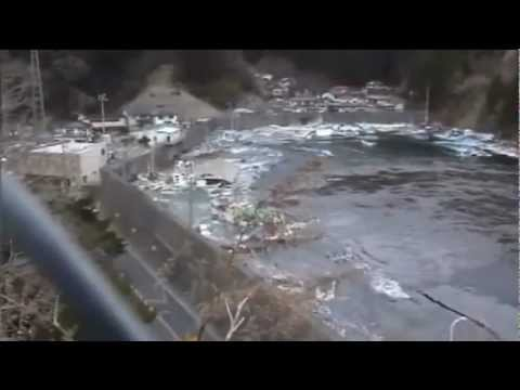 Ten-meter seawall breached and destroyed by tsunami