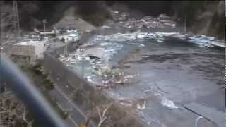 Ten-meter seawall breached and destroyed by tsunami thumbnail