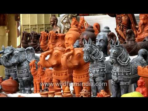 Terracotta idols and earthen lamps for sale in local market | Chennai