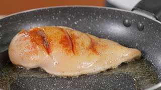 Chicken breast being fried in olive oil in a nonstick frying pan