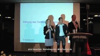Verlosung einer Renn-Taxi-Fahrt beim Marketingclub Mainfranken e.V. mit Andreas Pfister