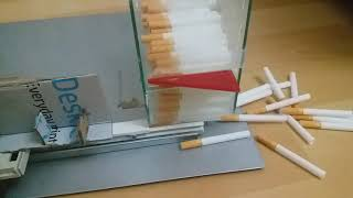 Tubing push device of personal cigarette rolling machine (Cigarette Rolling Machine)