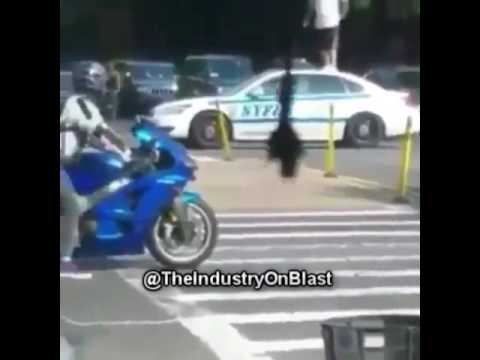 guy hops on nypd car while in motion