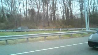باتمان يقود سيارته في الطريق السريع