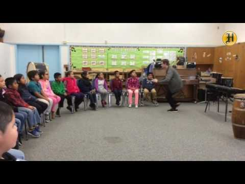 Mary Chapa music teacher William Bradle leads a group of third graders on a rendition of Jingle Bell