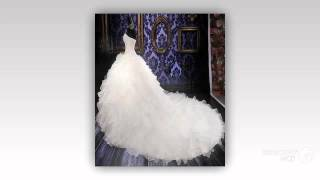 Платье, украшенное вышивкой из бисера, жемчуга. Со встроенным бюстгалтером и шлейфом.