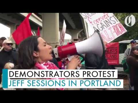 Demonstrators protest Attorney General Jeff Sessions in NW Portland